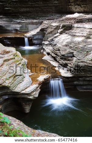 creek in forest with rocks and stream in Watkins Glen state park in New York State - stock photo
