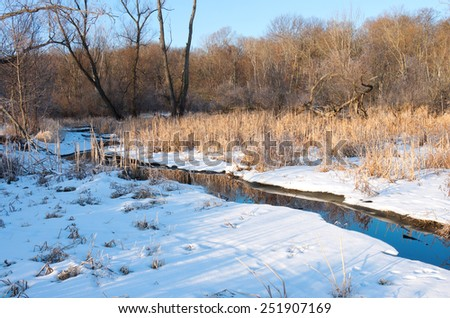 Creek running through marshes of minnesota valley national wildlife refuge in bloomington  - stock photo