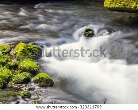 Creek with stones - stock photo