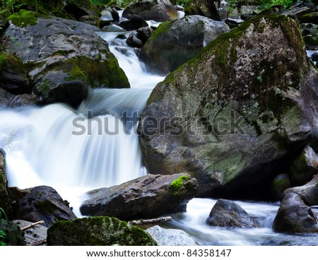 creek with water and stones in the mountains. - stock photo