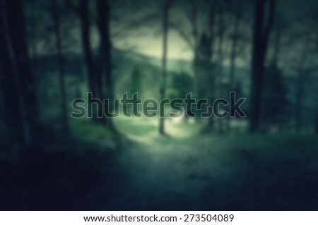 Creepy and scary background with house in the middle of dark forest for web usage - stock photo