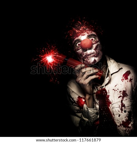 Creepy Business Person In Bloody Clown Suit Holding Stick Of Lit Dynamite On Black Studio Background
