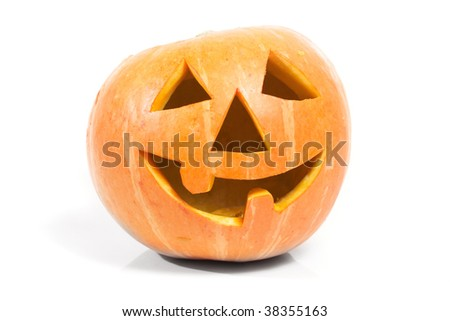 Creepy carved pumpkin face, with a smile