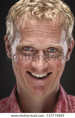 Creepy Caucasian Man Smiling - stock photo