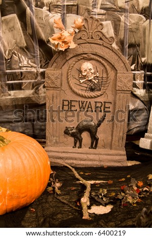 Creepy Halloween Graveyard Scene with Oak Leaves and Pumpkin - stock photo