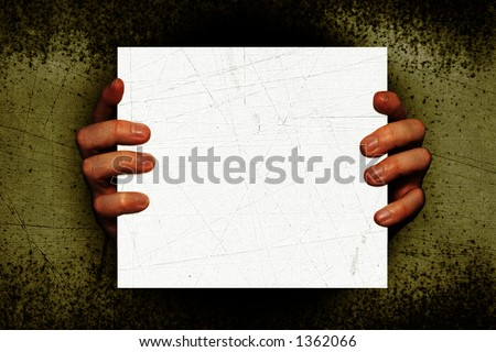 Creepy Hands holding a white blank sign on a grunge textured background. Add your own text or Image. This could make a nice halloween invitation - stock photo