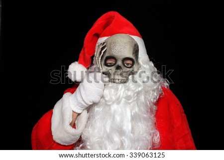 Creepy image of Santa Claus with a Skeleton Mask. Scary Santa Claus. Santa Claus Halloween Mask. Santa Skull. Santa Skeleton. Spooky Santa. Spooky Santa Claus.  - stock photo