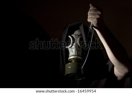 creepy masked man with knife - stock photo