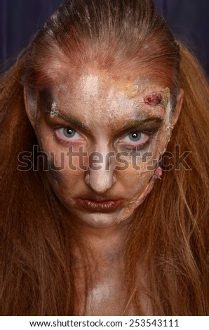 Creepy portrait of a halloween girl with artistic make up - stock photo