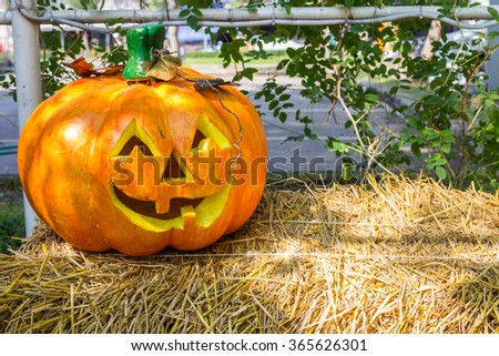 Creepy pumpkin face on rice straw background - stock photo