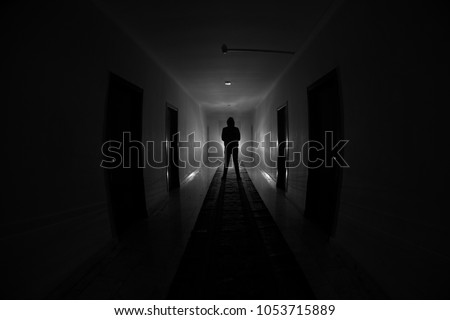 Creepy silhouette in the dark abandoned building. Horror about maniac concept or Dark corridor with & Spooky Door Stock Images Royalty-Free Images \u0026 Vectors | Shutterstock