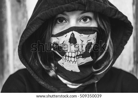 Creepy woman in black hood