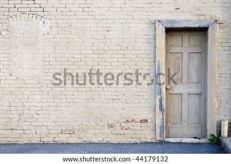 creme brick wall with door background - stock photo