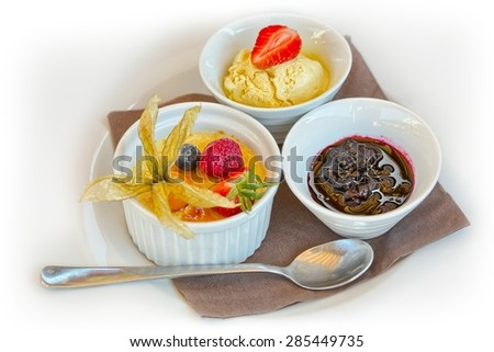 Creme brulee. French vanilla cream dessert with caramelised sugar on top with ice cream and fruit - stock photo