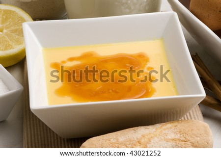 Creme brulee in a white bowl and biscuits. Selective focus. Crema catalana.