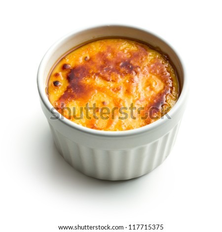 creme brulee in ceramic bowl on white background - stock photo