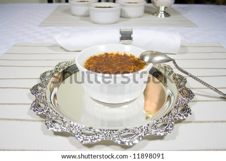 Creme Brulee served and ready. Light color theme - stock photo