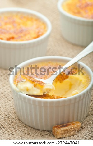 Creme brulee. Traditional French vanilla cream dessert with caramelised brown sugar on top. - stock photo