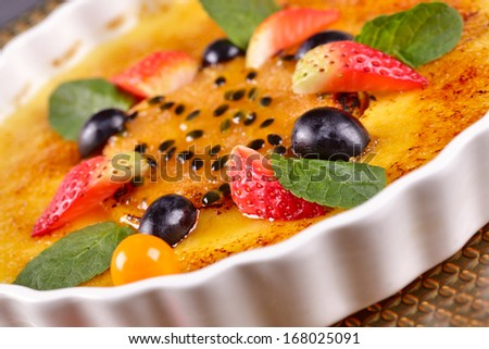 Creme brulee with berries - stock photo