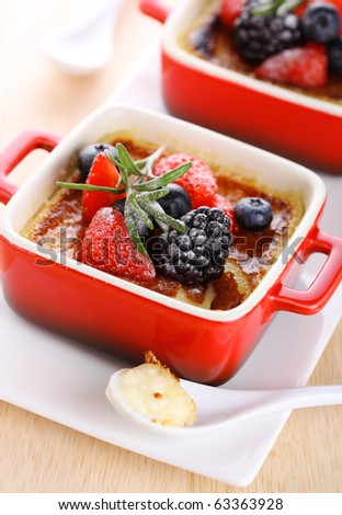 Creme brulee with fresh berries - stock photo