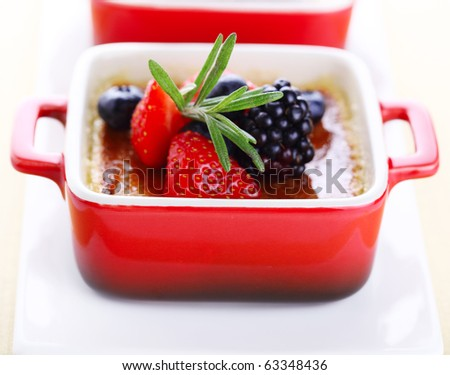 Creme brulee with fresh berries (blackberry; strawberry; blueberry)