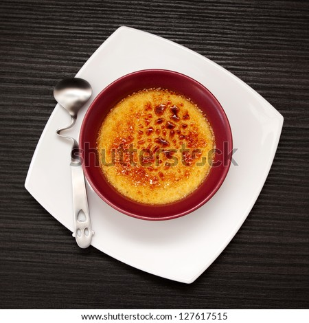 Creme Brulee with funny spoon - stock photo