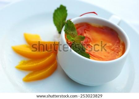 Creme Brulee with orange - stock photo