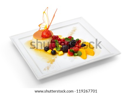 Creme Caramel with Fresh Berry Salad - stock photo
