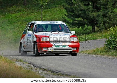 Cremona / Italy -  September 7, 2005 - Unidentified drivers on a white and red vintage Renault 5 racing car - stock photo