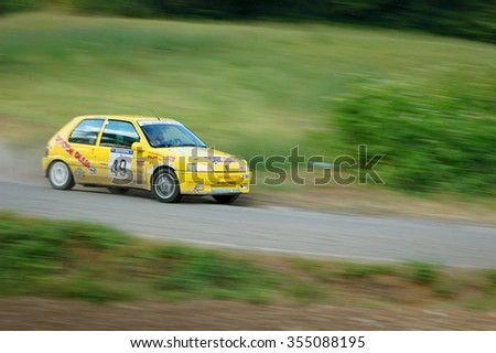 Cremona / Italy -  September 7, 2005 - Unidentified drivers on a yellow vintage Peugeot 105 racing car