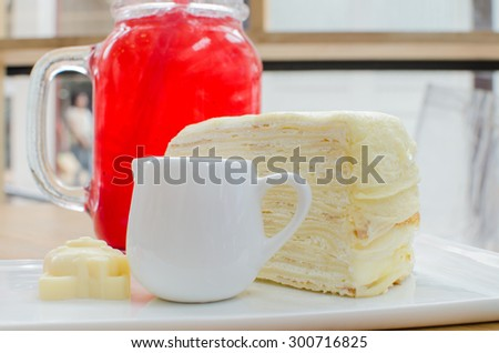 crepe cake serve with strawberry syrup - stock photo