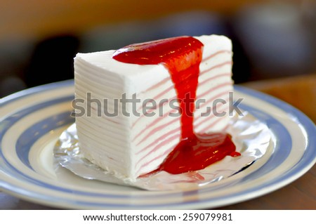 Crepe cake with strawberry sauce dish