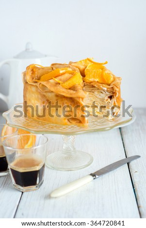 Crepe pancake cake with orange, selective focus
