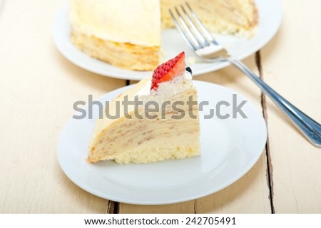 crepe pancake cake with whipped cream and strawberry on top - stock photo