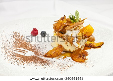 Crepe pancake with whipped cram and chocolate powder - stock photo