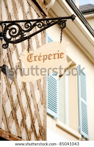 Creperie sign on historic house in Chartres, France - stock photo