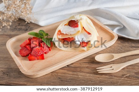 Crepes cake roll cream cheese with fresh strawberry. - stock photo