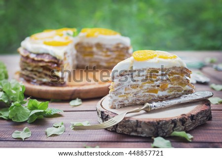 Crepes cake with peaches and cream - stock photo