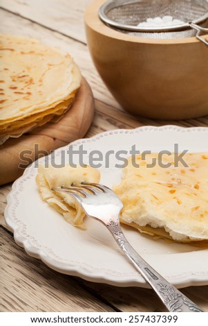 Crepes or pancakes and castor sugar.