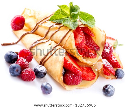 Crepes With Berries. Crepe with Strawberry, Raspberry, Blueberry and Chocolate topping. Pancake - stock photo