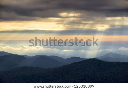 Crepuscular Light Rays and Sunbeams from Blue Ridge Parkway NC on a spring morning in the Appalachian Mountains near Asheville North Carolina - stock photo