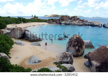 Crescent beach with granite boulders and turquoise waters.  The Baths.  British Virgin Islands.