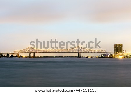 Crescent City Connection bridge in New Orleans illuminated at night. Louisiana, United States