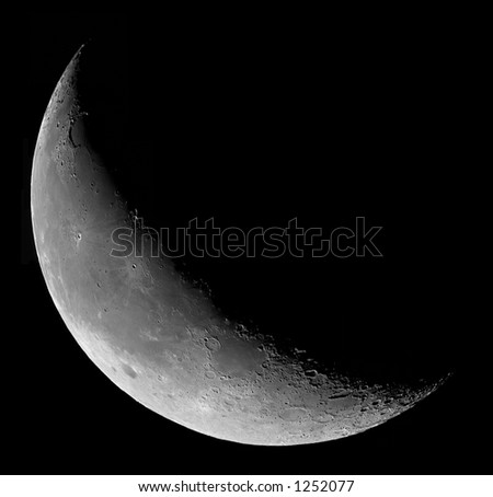 Crescent Moon as seen in the early morning prior to sunrise - stock photo
