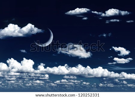 Crescent moon in dreamy night sky and clouds - stock photo