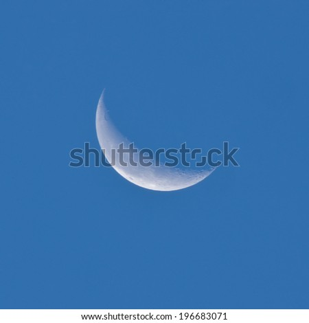 Crescent moon in the night sky - stock photo