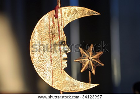 Crescent Moon with face and star with dripping candle wax. - stock photo