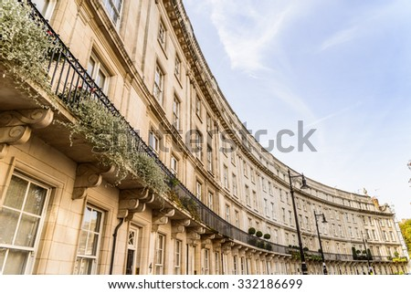 crescent - traditional row of terraced houses in London - stock photo