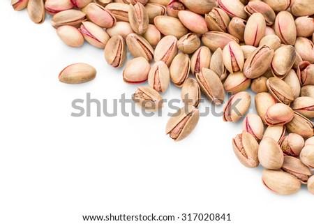 Cretan pink pistachios as background, greek food, top view - stock photo