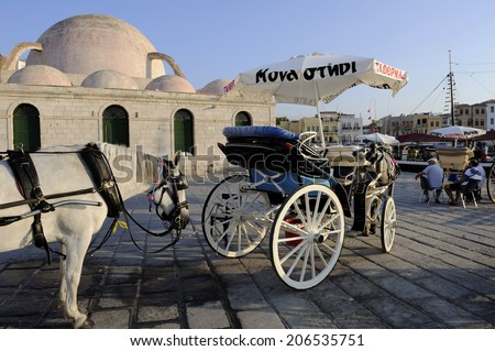 Crete, Greece, - August. 29. 2008: Horse carriage and mosc at Chania, town on Crete, Greece. Old town and harbor is surrounded by the old Venetian fort that started to be built in 1538